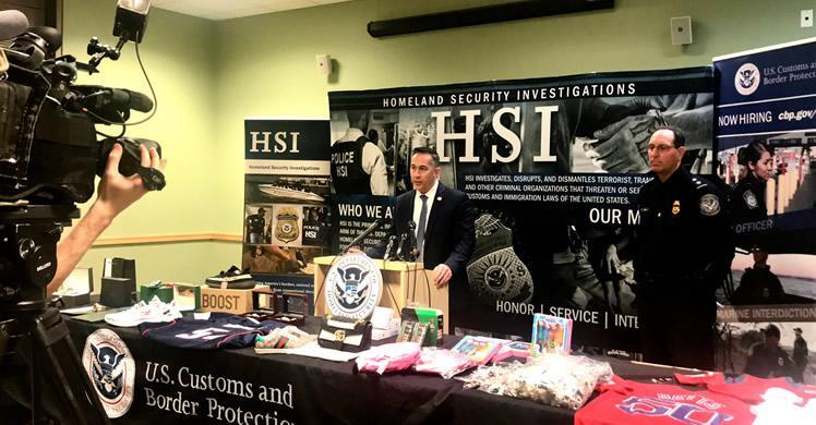 Homeland Security Investigations (HSI) Boston acting Special Agent in Charge Jason Molina and Customs and Border Protection Director of Field Operations, Boston Michael Denning highlight the risks of purchasing counterfeit property items, in front of recently-seized items .
