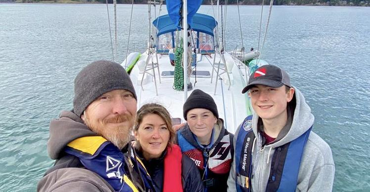 HSI Special Agent Steven M.,his wife Bobbi, sons Hunter, 17, and Chance, 13, pose for a family photo, March 23, before taking off on a family boating trip to the Strait of Juan de Fuca, where they later saved a man in danger of drowning.
