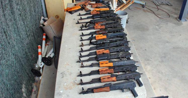15 AK47 assault type rifles that were discovered hidden inside a pickup truck