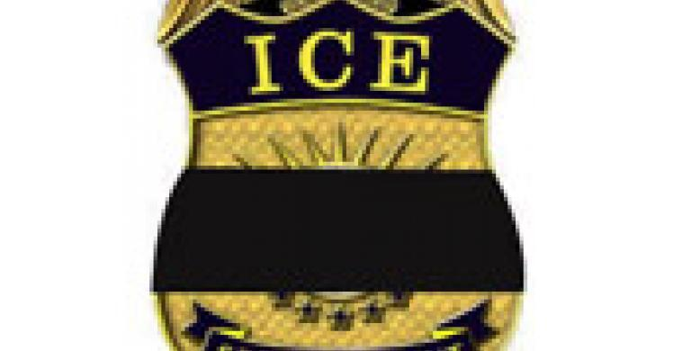 ICE badge with black band