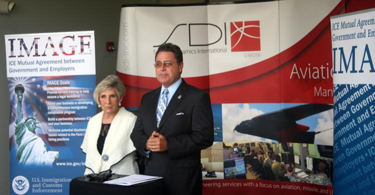 HSI New Orleans SAC Raymond R. Parmer Jr. and System Dynmamics International CEO Pamela Barratt White announce the company's IMAGE certification in Huntsville, Ala.