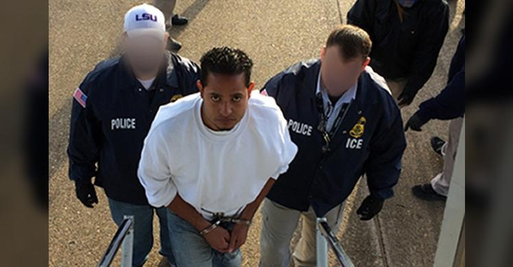 Marlon Joel Paz-Mendoza boards a plane for return to Honduras, where he has been convicted of murder.