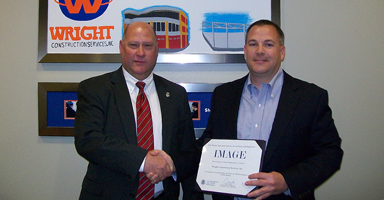 From left: James Gibbons, of HSI Chicago and  Daniel Dreckmann of Wright Construction Services