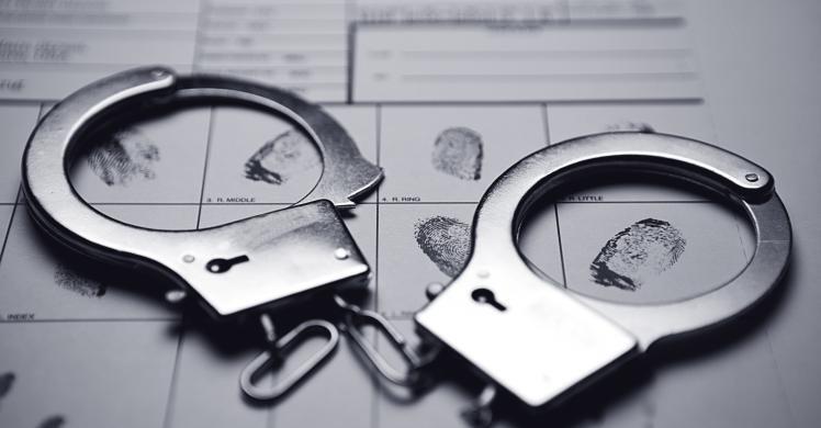 image of handcuffs on a fingerprint sheet