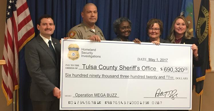 The check for $690,320.23 represents TCSO's share of monies and assets seized from one defendant in Operation MEGA BUZZ, which is divided among the participating agencies as part of ICE's asset-sharing agreement