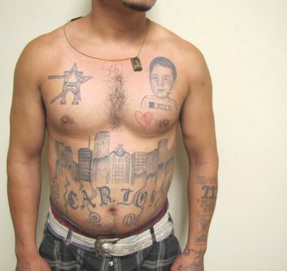 gang member covered with tattoos