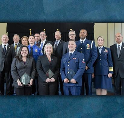 Secretary Johnson and Deputy Secretary Mayorkas pose with Valor Award winners