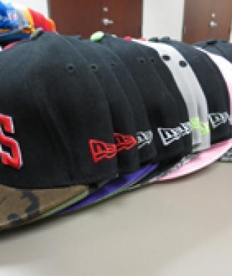 HSI seizes nearly 800 counterfeit sports team hats, jerseys