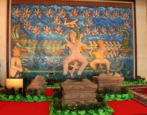 Photo of all 3 statues at the ceremony. Next to each statue is the actual solid sandstone base that each was hacked off of and which they transported to the ceremony from Prasat Chen.