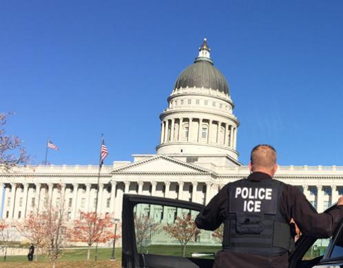 SLC Deportation Officer standing before Utah State Capitol.