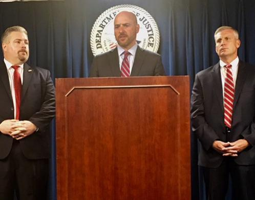 Left to right: Peter Fitzhugh, HSI special agent in charge, discusses the arrest as U.S. Attorney for Massachusetts Andrew E. Lelling and Harold H. Shaw, special agent in charge, FBI Boston Field Division, look on.
