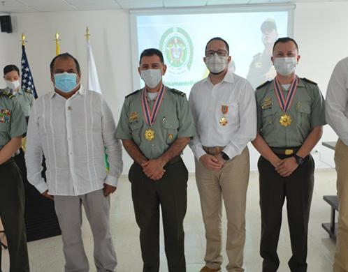 National Colombian Police with Special Agent Miguel Palomino (second from left), Regional Attaché Brian Vicente (fourth from left), Ops Manager Randy Richardson (far right).