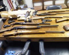 weapons seized during raid in Del Rio, TX