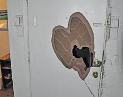 A fortified door to one of the brothels that was broken into by HSI special   agents and task force officers from Tulsa County Sheriff's Office during   Operation Poker Chip.