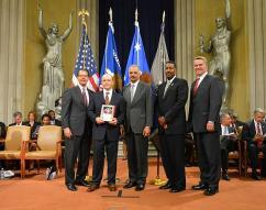 Andrew Choate, SAUSA, District of Utah, receives an award from U.S. Attorney General Eric Holder with HSI Executive Associate Director Peter Edge (second from right).
