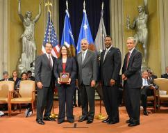 Beth N. Gibson, SAUSA, District of Colorado, receives an award from U.S. Attorney General Eric Holder with HSI Executive Associate Director Peter Edge (second from right).