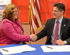 Laurie Hebert, Director of Talent Management and Employee Relations, Big Y Foods, Inc. and Matthew Etre, SAC, HSI  Boston.
