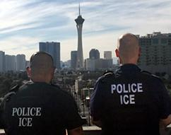 SLC Deportation Officers standing before Stratosphere and Las Vegas Strip.