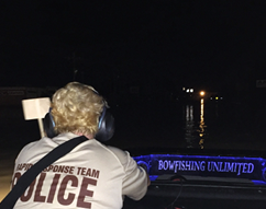 Rapid Response Team member manning a boat.