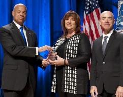 Secretary of Homeland Security Jeh Johnson and Deputy Secretary of Homeland Security Alejandro Mayorkas presented the Secretary's Award for Exemplary Service to Susan M. Bokor.