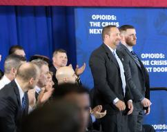 President Donald J. Trump recognizes law enforcement officers, HSI-Manchester Special Agent Ronald Morin (left) and Manchester, NH, Police Detective, and HSI Task Force Officer Patrick Maguire for their role in addressing the issue through Human Trafficking investigations, as President Trump deliver remarks on combating the opioid crisis at Manchester Community College, Monday, March 19, 2018, Manchester, NH. (Official White House Photo by Andrea Hanks)