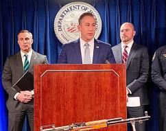 HSI Boston acting Special Agent in Charge Jason J. Molina outlines HSI's participation in the long-running investigation as Federal Bureau of Investigation, Boston Field Division Special Agent In Charge Joseph R. Bonavolonta (left) and U.S. Attorney for Massachusetts Andrew E. Lelling (right) listen.
