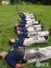 Physical fitness training gets down and dirty for Honduran students at the Federal Law Enforcement Training Center